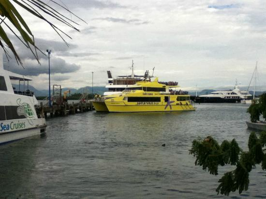 Tanoa International Hotel: High speed catamaran (yellow) returning from Yasawas (outer islands day trip)