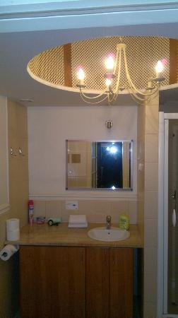 Old Town Apartments : Toilet and bath with elegant chandelier!