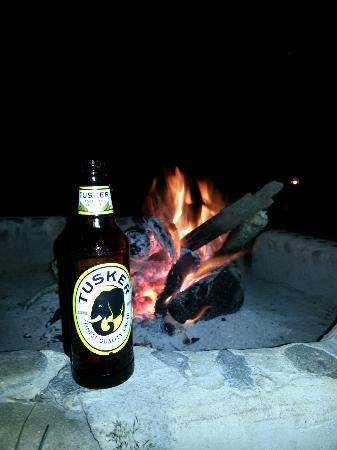 Mara Eden Safari Camp: Ice cold Tusker by the camp fire. Just the way to wind-down.