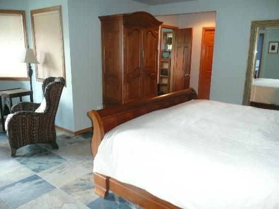 Enliven Chemical-Free Bed and Breakfast: Suite Mama Blue/ the All Together Suite. Door to the optional twin room is just beyond armoire.