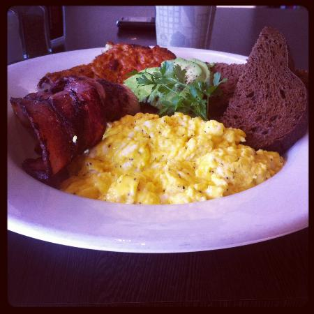 BOB: Yummy breakfast. Bacon, scrambled eggs, avocado, potato hash on rye bread