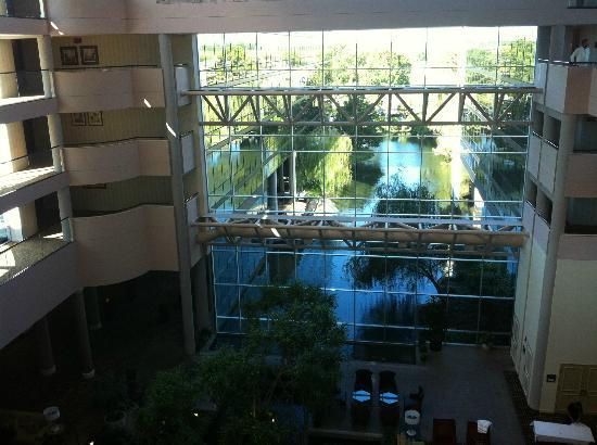 Omni Houston Hotel Westside: View of glass wall inside hotel looking out