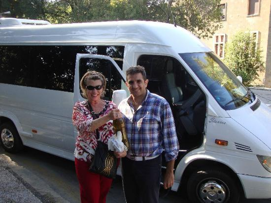 Rhodes Wonder - Private Taxi Tours: My wife Nancy and Stavros with the bottle of olive oil he so kindly gave us.