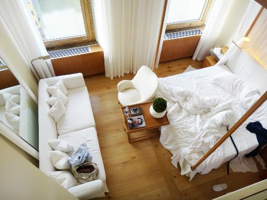 Continentale: Looking down from upper level to the bed and sofa.