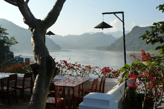 The Grand Luang Prabang Hotel & Resort: dining on the terrace of the hotel with view on the Melong