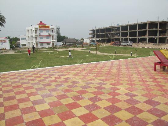 Debraj Beach Resort: looking across sundeck & lawn towards new building & under construction one