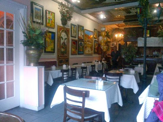 Jericho Lebanese Food : View of the restaurant with owner's colourful paintings on the walls and ceilings.