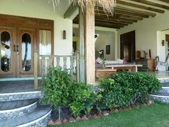 Life in Amed Boutique Hotel: 100 year old teak doors, Perfumed Garden