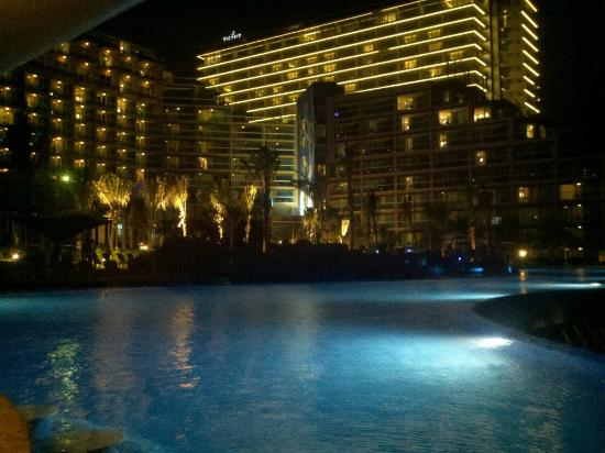 Hard Rock Hotel Cancun: View of the hotel from the pool at night.