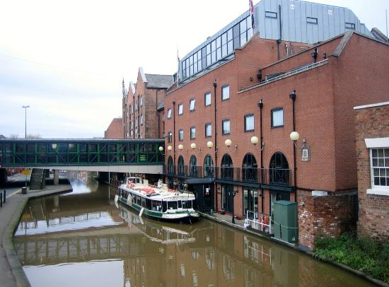 The Mill Hotel: Back of hotel from nearby bridge.
