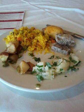 Mandaloun: Lamb pieces, rice, a cold potato dish, and a hot/spicy potato dish