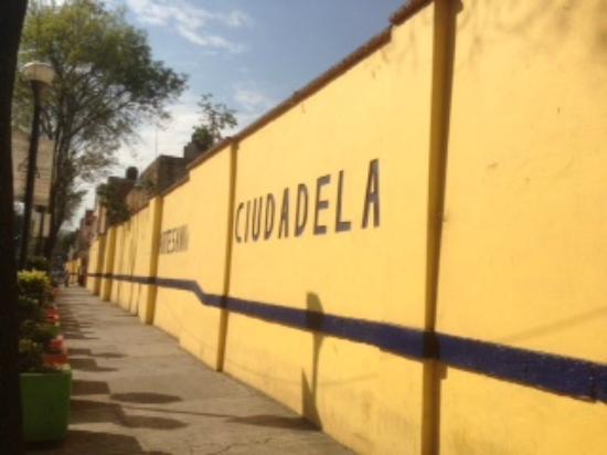 "Mercado de Artesanias La Ciudadela : The exterior wall of the market facing the public park of the same name, ""The Citadel."""