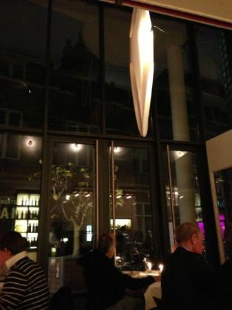 Floc Restaurant: View of the main light fixture and the facade of the restaurant