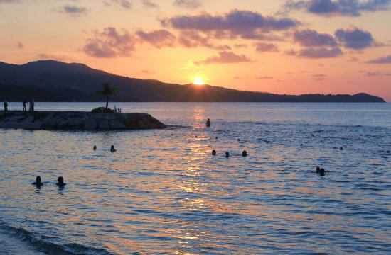 Secrets St. James Montego Bay: Swimmers at sunset