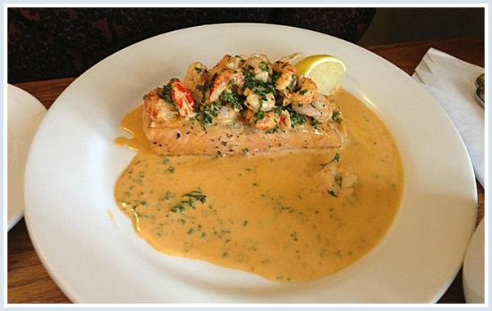 Village Limits Restaurant: Salmon fillet with a delicious prawn and shrimp garnish/sauce