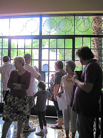 Merida English Library House & Garden Tours: Tour participants take time to visit.