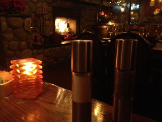 Vail Ranch Steakhouse: Fireplace from table view and these are the BRST SALT AND PEPPER GRINDERS