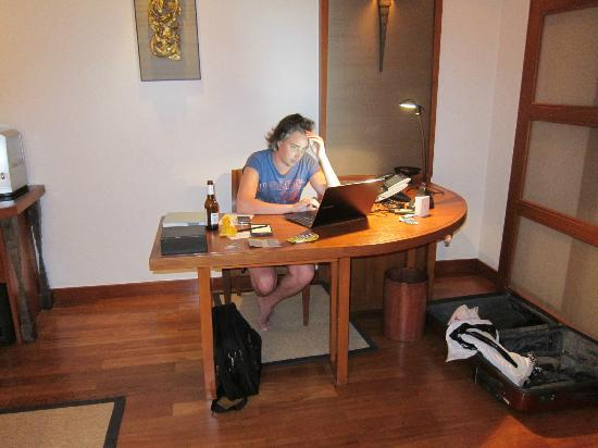 The Sukhothai Bangkok: My son at work in our room
