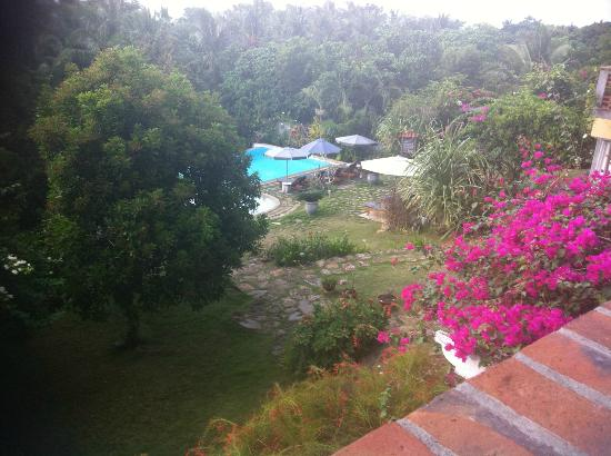 Amarela Resort: view from diniing area down to pool area and grounds