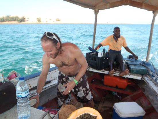 Marimba Secret Gardens: Marcel preparing fresh fruits on the way back from snorkeling