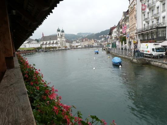 Hotel des Alpes: Standing on Chapel Bridge - Hotel is on the right with market setting up