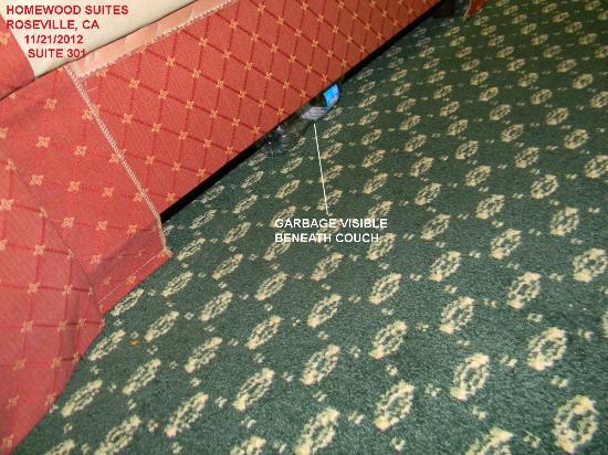 Homewood Suites by Hilton Sacramento-Roseville: Garbage under sofa