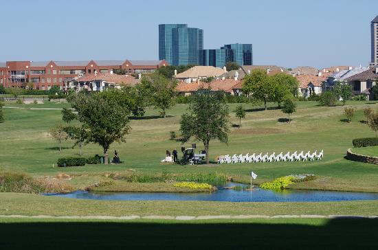Four Seasons Resort and Club Dallas at Las Colinas: The wedding site being set up nearby the lake with babbling brook.