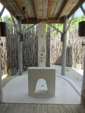 Six Senses Laamu: outdoor shower of the beach villa
