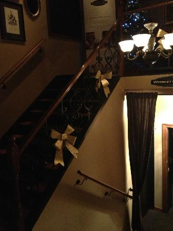 O'Finn's Irish Temper : The stairs up to the restaurant and down to the whiskey lounge.