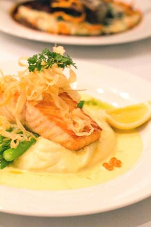 Allure on Currumbin: Pan-seared Atlantic salmon with truffled mash, grilled asparagus, crisp parsnip and salsa verde