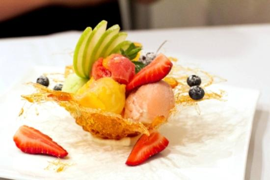 Allure on Currumbin : Homemade sorbets and fresh seasonal fruits in a spun toffee basket