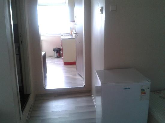 Eroglu Apart: The fridge who divided the 4 beds in the bedroom, kitchen is straight agaid...