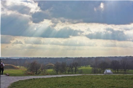 Cahokia Mounds State Historic Site: Sunrays highlight mounds from the top of Monk's Mound