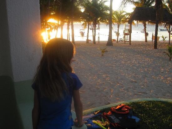 Hotel Akumal Caribe: my youngest on back porch contemplating an early AM snorkel with dad