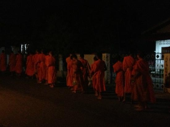 My Dream Boutique Resort: Monks on street right outside the hotel in the early morning.