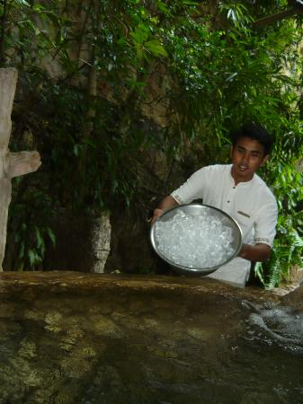 The Banjaran Hotsprings Retreat: Staff pouring ice into the ice dipping pot