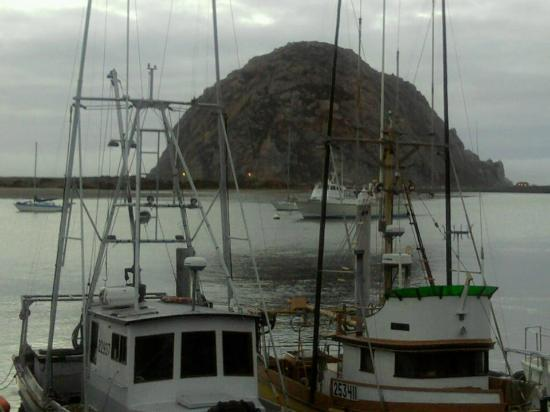 Morro rock through fishing boats at giovanni 39 s picture for Giovanni s fish market