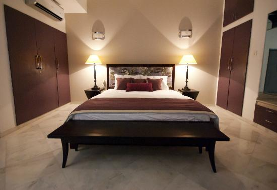 Secludecity - Safdarjung Enclave: Master bedroom(Purple room.)