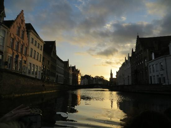 Huis Koning: canal view at sunset