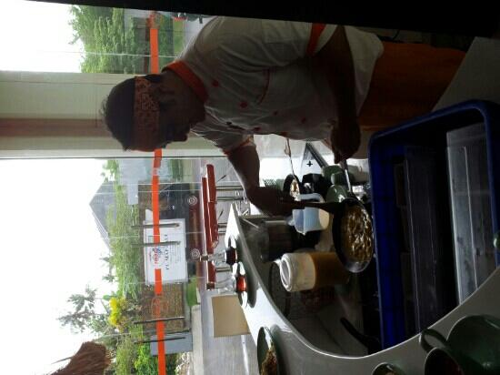 HARRIS Hotel & Residences Sunset Road: Chef Benny cooking up his masterpiece..