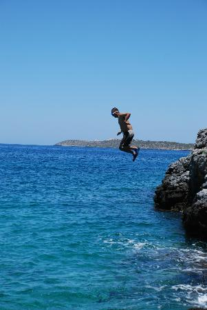 Giorgi's Blue Apartments: A team member rock jumping 64 seconds from the pool.