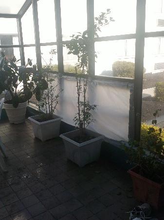 Baymont Inn & Suites Branford / New Haven: plastic tarp covering broken window in pool area
