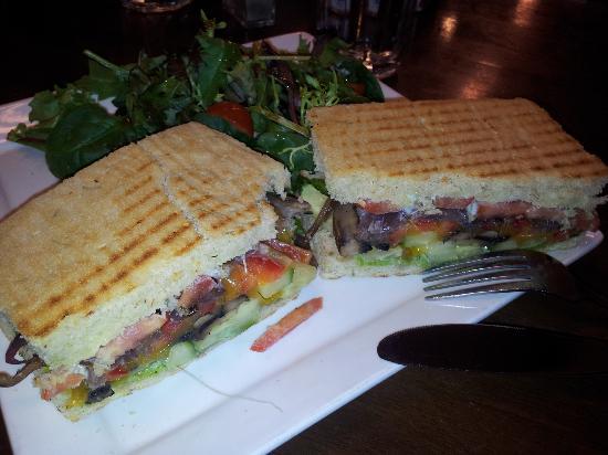 "Casa Mia Restaurant : ""Veggie stack"" sandwich on focaccia with side salad."