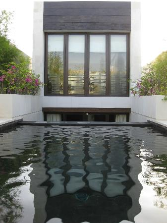 eqUILIBRIA SEMINYAK: view looking at the villa from the pool deck