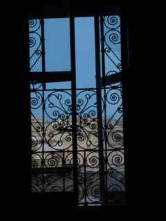Dar Sienna: this is the view from MY BED! I just love the wrought iron!