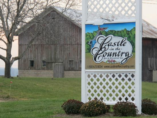 Castle in the Country Bed & Breakfast Inn: Castle in the Country Sign, old barn across the road serves as backdrop.