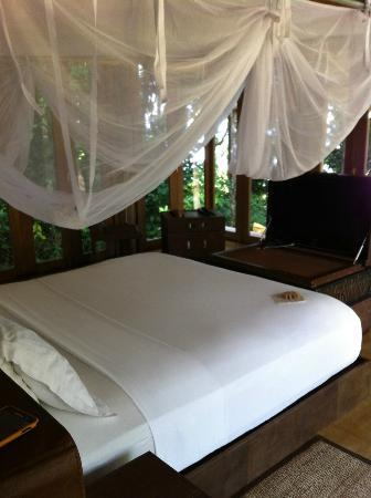 Soneva Kiri Thailand: bedroom area with funny TV into baggage