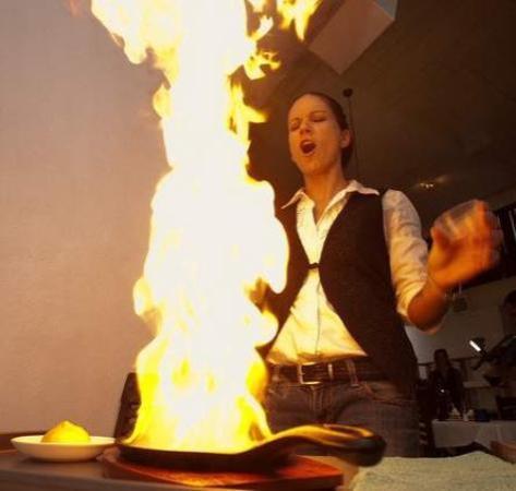 Feta Mediterranean Cuisine: our server tara lightning up a signature dish the 'saganaki'