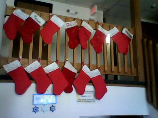 Super 8 Kingdom City : Second floor railing over lobby, 2012 employee Christmas stockings