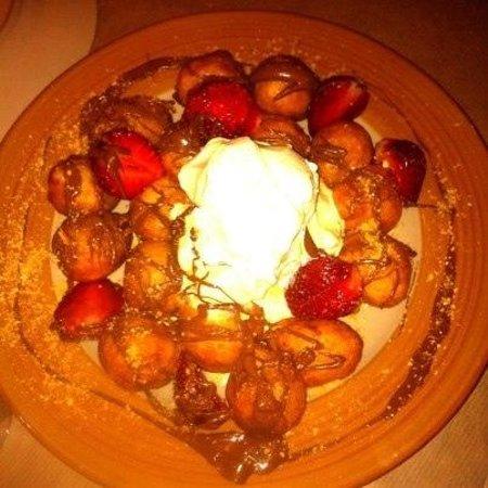 "Gyro Gyro Oloi: traditional ""loukoumades"" with vanilla ice cream-strawberries-chocolate"
